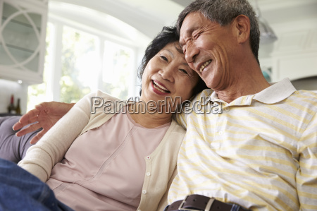 senior asian couple at home relaxing