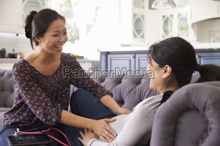 pregnant woman being examined at home