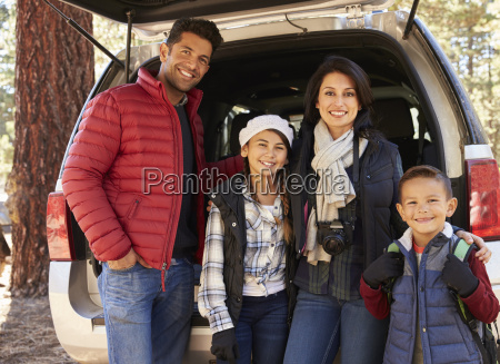 portrait family outdoors standing at the