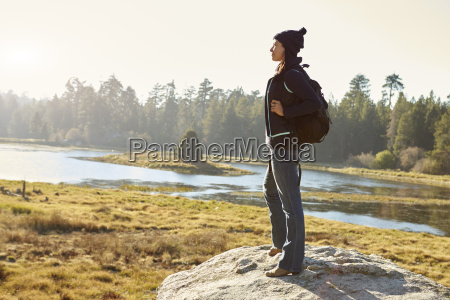 young adult woman standing alone on