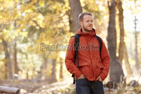 young adult caucasian man walking in