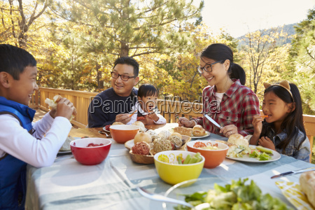 asian family eating outside at a