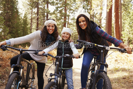 female parents cycling with their daughter