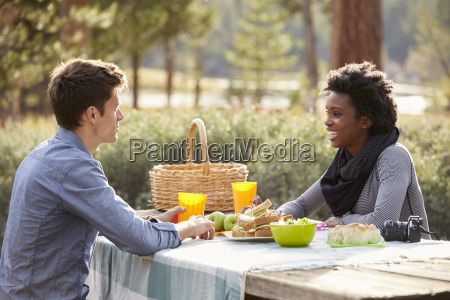 caucasian man and black woman talking