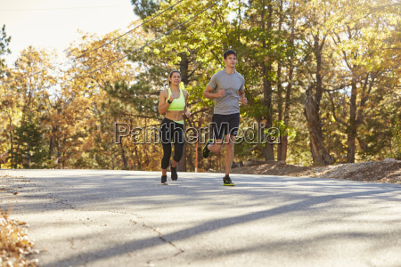 woman and man jogging on a