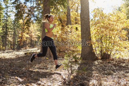 young adult woman running in a