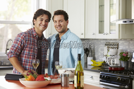 smiling male gay couple preparing a