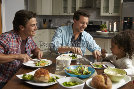 male couple and black daughter dining