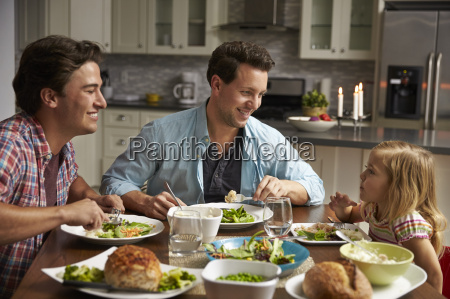male gay couple and daughter dining