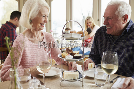 senior couple enjoying afternoon tea in