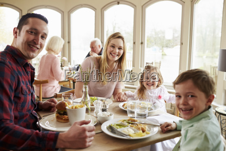 family enjoying meal in restaurant together