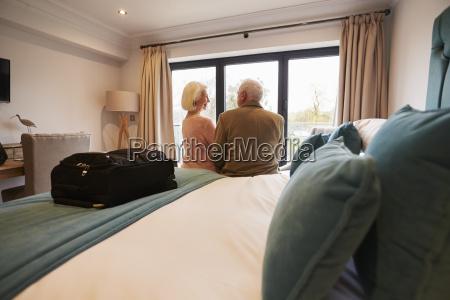 senior couple on vacation sitting on