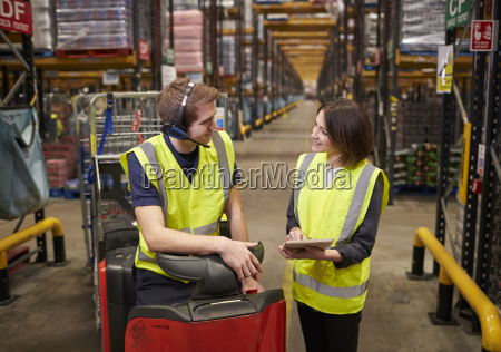 female warehouse manager and man on