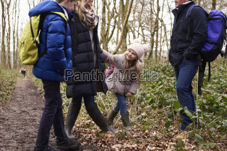 family stand in a wood their