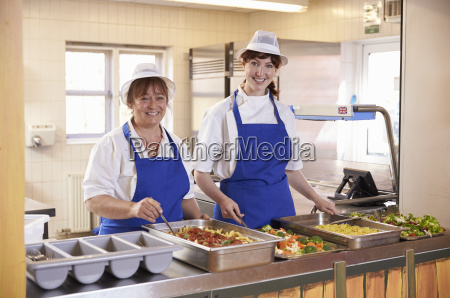 two women waiting to serve lunch