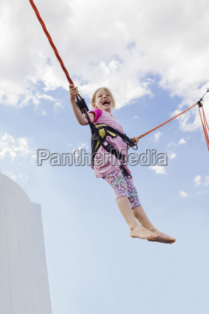 6 year old girl jumping with