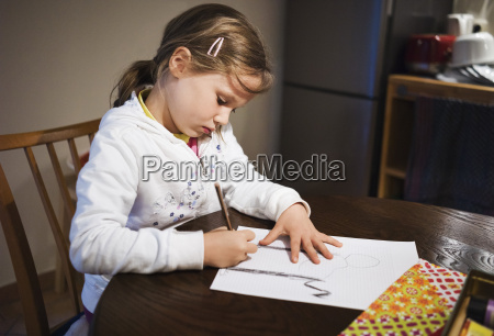 5 year old girl sitting at
