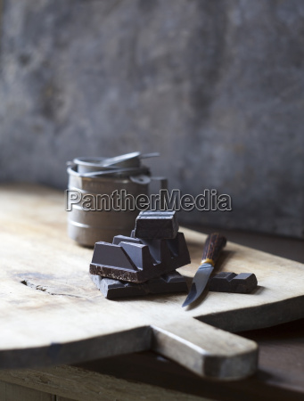 chunks of chocolate on wooden cutting
