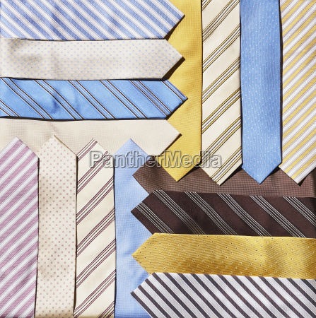 group of pastel colored neckties layered