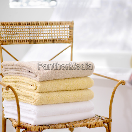 stack of fresh towels on wicker