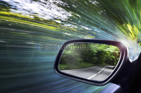 view of road reflected in cars