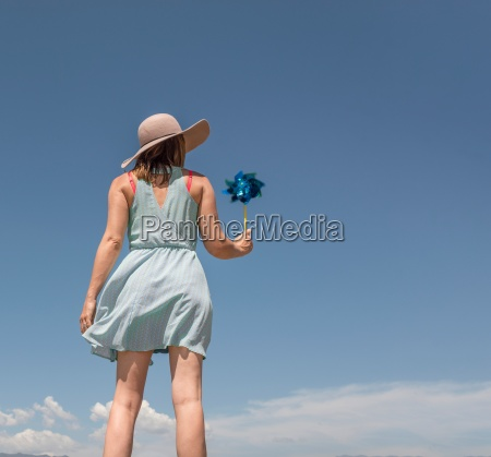 rear view of woman with hat