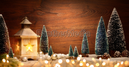 christmas arrangement with lantern trees balls