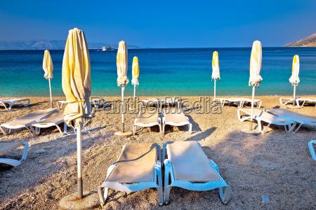 idyllic turquoise beach parasol and deck