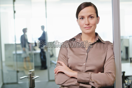 mid adult woman standing in office