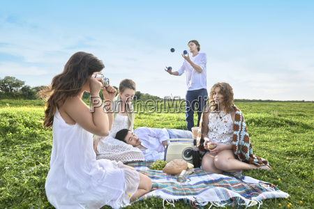group of young adult friends having