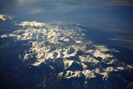 aerial view of snow capped mountains