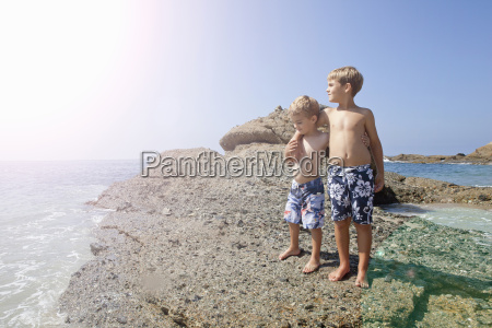 brothers playing on beach laguna beach