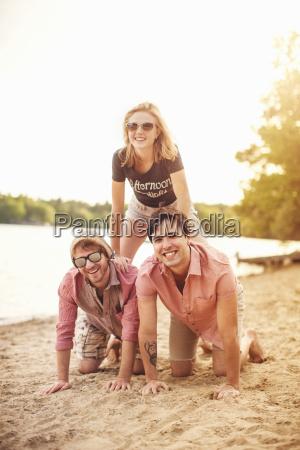 three friends on beach portrait