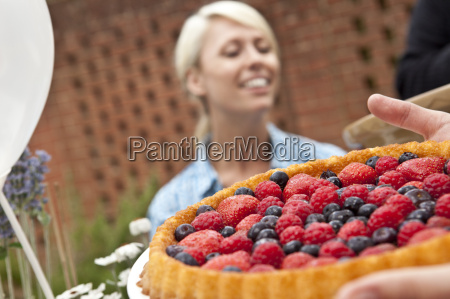 two female friends with fruit flan