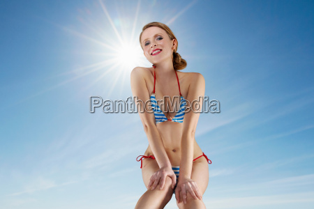 woman wearing bikini against blue sky