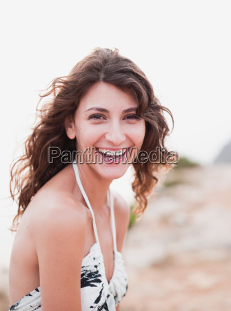 woman in dress smiling at viewer