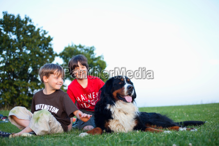 two boys with huge dog