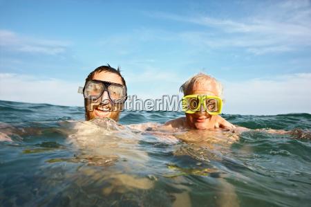 portrait of two men swimming in