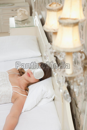 woman on hotel bed with sleeping