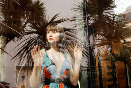 woman looking at window