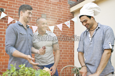 male friends laughing at chefs hat