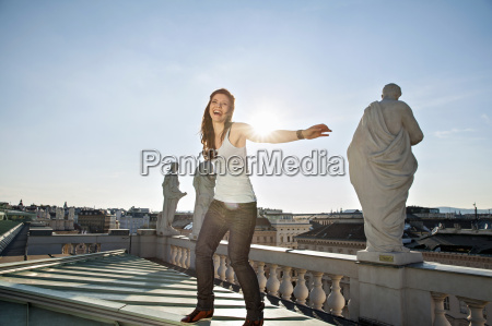 young adult woman laughing on rooftop