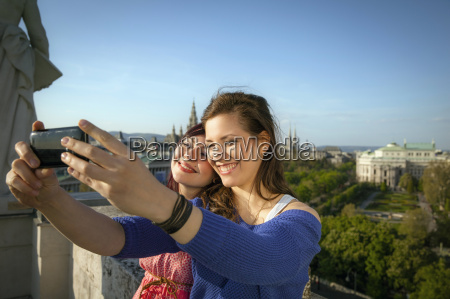 two young women taking self portrait
