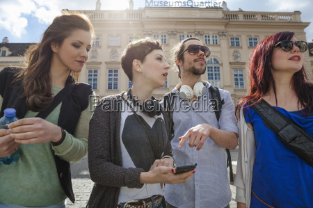 group of young adults sightseeing