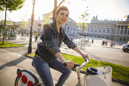 young, adult, woman, cycling, through, city, - 19434100
