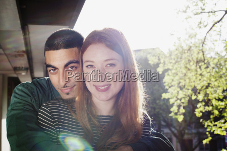 young couple with arm around standing