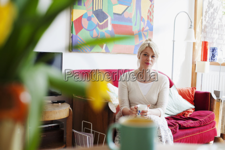 young woman relaxing in living room