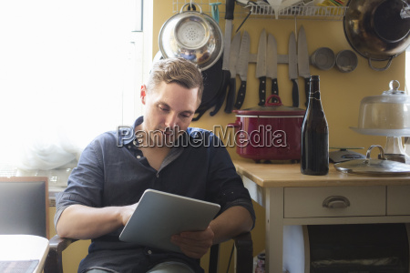 mid adult man checking information on