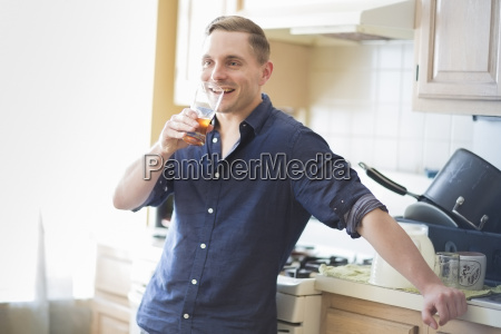 mid adult man checking taste of