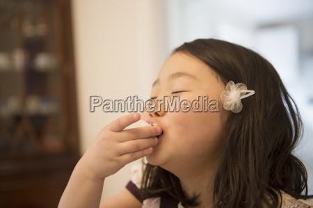 young girl enjoying a snack